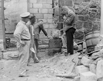 ​​​​Mortar being placed around cornerstone of Cellblock 15 (Death Row), 1956; Photo: collection of Eastern State Penitentiary Historic Site, gift of Alan J. LeFebvre.