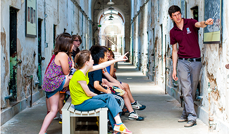 Students taking a guided tour of Eastern State Penitentiary